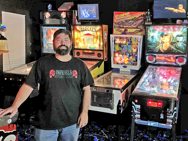 Space Vehicle engineer and Pinball wizard Scott Schreiber fulfills kid's dream in Bealeton home with a collection of 100 retro arcade and pinball games.