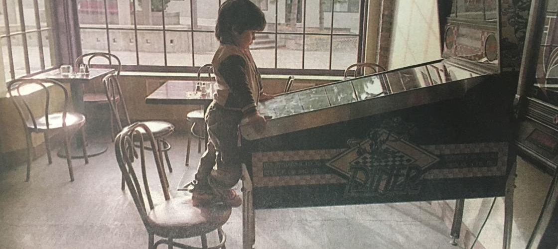 Four-year-old Cody Stevens sharpens his pinball skills while passing the time recently at his father's tavern and restaurant, Spirits.