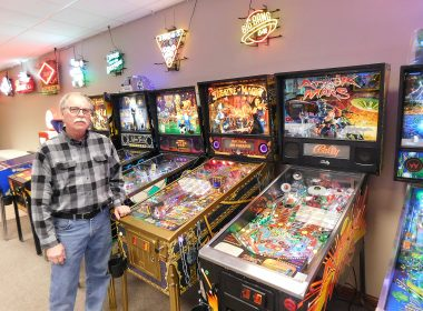 Minnesota Pinball hobby blooms into a business as Vorwerk stands next to a small sample of his pinball collection at The Pinball Place.