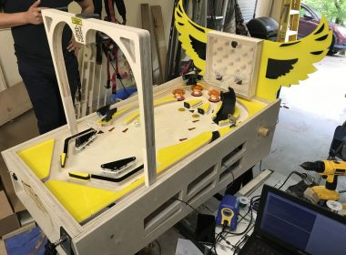 As an enviable senior design project at Kennesaw State University, students Tyler Gragg, Kevin Kamperman, Cody Meier, and Omar Salazar Lima created their own autonomous pinball machine.